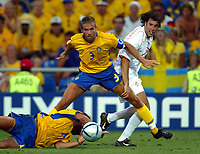 Faro 27/6/2004 Euro2004 <br />Svezia - Olanda 4-5 after penalties (0-0) <br />Olof Mellberg of Sweden and Ruud Van Nistelrooy of Netherlands <br />Photo Andrea Staccioli Graffiti