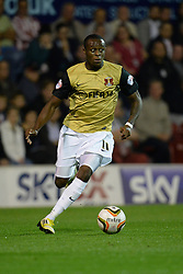 Leyton Orient's Moses Odubajo runs with the ball  - Photo mandatory by-line: Mitchell Gunn/JMP - Tel: Mobile: 07966 386802 23/09/2013 - SPORT - FOOTBALL -  Griffin Park - London - Brentford v Leyton Orient - Sky Bet League One