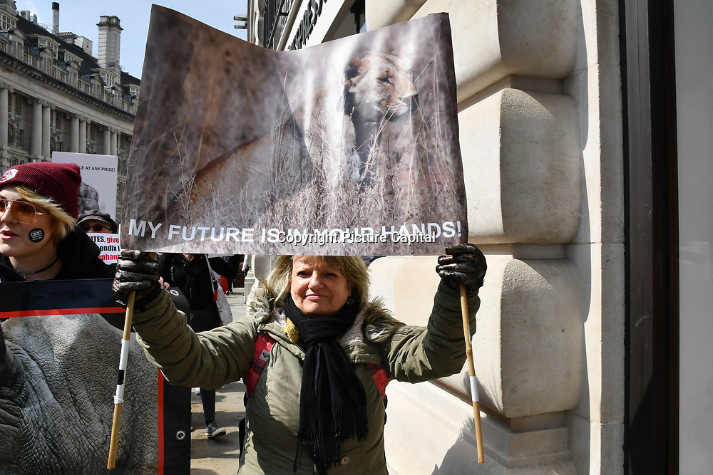 Hundreds join the 5th Global March for Elephants and Rhinos march against extinction and trophy hunting murdering and killing animals for blood spots and ivory trade on 13 April 2019, London, UK.