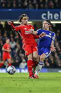 Filipe Luis of Chelsea (right) and Lazar Markovic of Liverpool (left) during the Capital One Cup Semi Final 2nd Leg match between Chelsea and Liverpool at Stamford Bridge, London, England on 27 January 2015. Photo by David Horn.