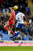 Reading defender Andy Yiadom (3) and Nottingham Forest midfielder Matthew Cash (14)  during the EFL Sky Bet Championship match between Reading and Nottingham Forest at the Madejski Stadium, Reading, England on 12 January 2019.