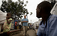 Joel is a producer of a Christian movie that he screen in the camp in Haiti and convert Haitian to Christianity..In the photo walking in a camp in the city of Port Au Prince,.Haiti .Faraday February  26/2010.Keeping with a long tradition of Christian missionary work in Haiti, the January 2010 earthquake brought huge numbers of Christian organizations to the country to help the devastated population with food, shelter and spiritual guidance. But the earthquake has had another, less obvious impact. Haiti has a large traditional Voodoo population. Some evangelical Christian groups not only dismiss the Voodoo religion as a Satanic cult, but in fact blame practitioners for the earthquake, saying it was God's punishment. Voodoo spiritual leaders say this belief has led to disparate treatment of earthquake victims by Christian aid groups, with Christian converts getting better tents and food, and Voodoo congregations left unattended. The tension has erupted into violent clashes and attacks onVoodoo temples in Carrefour and Cité Soleil. Voodoo leaders say missionaries are using the promise of food and medical supplies to lure people to religious meetings to convert them and complain international aid is only going to Christian groups.