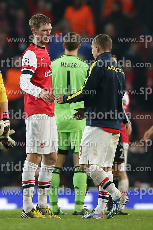 19.02.2013, Emirates Stadion, London, ENG, UEFA Champions League, FC Arsenal vs FC Bayern Muenchen, Achtelfinale Hinspiel, im Bild, Per MERTESACKER (FC Arsenal London - 4) und Lukas PODOLSKI (FC Arsenal London - 9) nach dem Spiel // during the UEFA Champions League last sixteen first leg match between Arsenal FC and FC Bayern Munich at the Emirates Stadium, London, Great Britain on 2013/02/19. EXPA Pictures © 2013, PhotoCredit: EXPA/ Eibner/ Gerry Schmit..***** ATTENTION - OUT OF GER *****