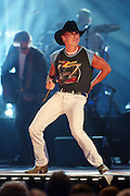Kenny Chesney performs during the first ever CMT Flameworthy Video Music Awards at the Gaylord Entertainment Center in Nashville, Tennesee.  6/12/02  Photo by Scott Gries/PictureGroup