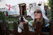 Pamela Shaffy with her pet dog. England Football team supporters during the 2006 World Cup. Kingsbury. North London. 24 June 2006.