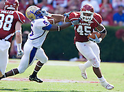 FAYETTEVILLE, AR - NOVEMBER 1:   D.J. Williams #45 of the Arkansas Razorbacks stiff arms DeAundre Brown #5 of the Tulsa Golden Hurricanes at Donald W. Reynolds Stadium on November 1, 2008 in Fayetteville, Arkansas.  The Razorbacks defeated the Golden Hurricanes 30 to 23.  (Photo by Wesley Hitt/Getty Images) *** Local Caption *** D.J. Williams; DeAundre BrownUniversity of Arkansas Razorback Men's and Women's athletes action photos during the 2008-2009 season in Fayetteville, Arkansas....©Wesley Hitt.All Rights Reserved.501-258-0920.