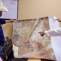 Chapter president Ronald Gishey, left, and chapter manager Art Hardy review a map of recently completed and proposed new sites for electric power lines at Greasewood Springs Chapter Tuesday.