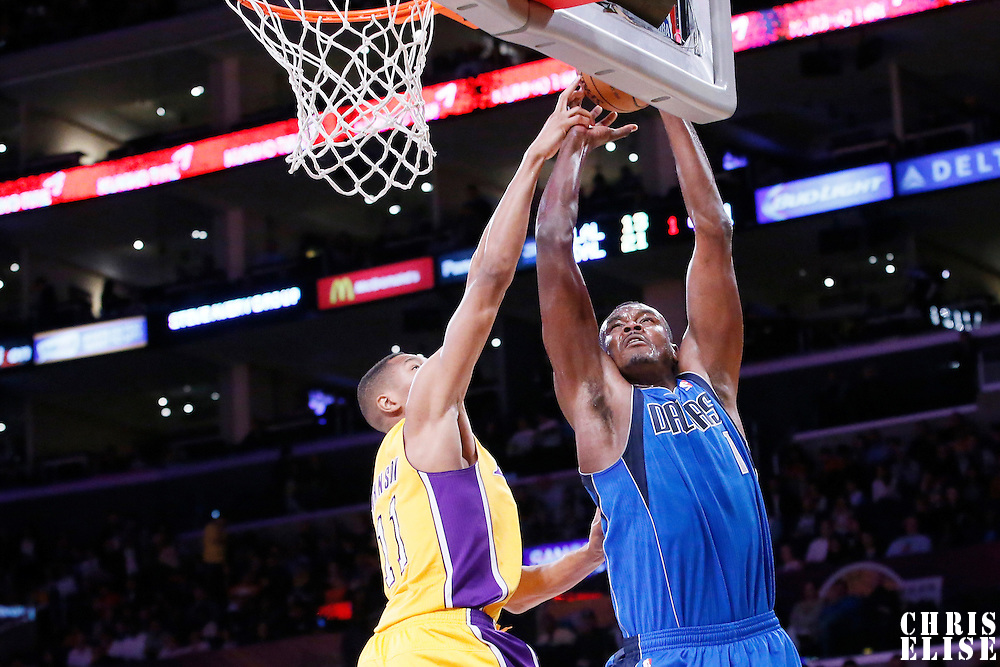 04 April 2014: Dallas Mavericks center Samuel Dalembert (1) is blocked by Los Angeles Lakers forward Wesley Johnson (11) during the Dallas Mavericks 107-95 victory over the Los Angeles Lakers at the Staples Center, Los Angeles, California, USA.