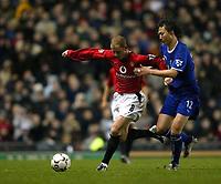 Photo. Aidan Ellis.<br /> Manchester United v Everton.<br /> FA Barclaycard Premiership.<br /> 26/12/2003.<br /> United's Nicky Butt and Everton's Li Tie