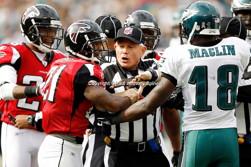 An official breaks up an altercation between Philadelphia Eagles wide receiver Jeremy Maclin (18) and Atlanta Falcons cornerback Christopher Owens (21) during the NFL week 6 football game against the Atlanta Falcons on Sunday, October 17, 2010 in Philadelphia, Pennsylvania. The Eagles won the game 31-17. (©Paul Anthony Spinelli)