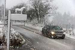 © Licensed to London News Pictures. 09/02/2016. Builth Wells, Powys, Wales, UK. A motorist negotiates the B4520 (Brecon road) between Builth Wells & Brecon during the blizzard. After a long unseasonably warm spell of weather in Mid Wales, temperatures drop in and the high land of the Mynydd Epynt range, near Builth Wells in Powys, Wales, is hit by a blizzard late this afternoon. Photo credit: Graham M. Lawrence/LNP