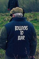 Fox Hunting.England, January 29th, 2005 - A foot follower on the field wearing a jacket with message