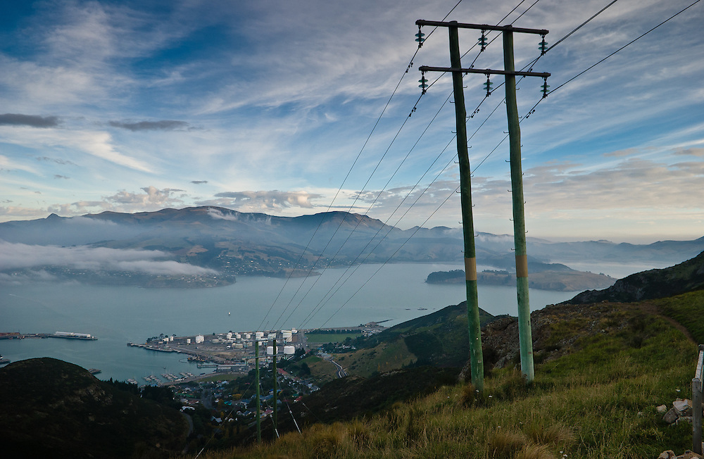 Overhead high-tenision power lines crest the Port Hills into Lyttelton Harbour