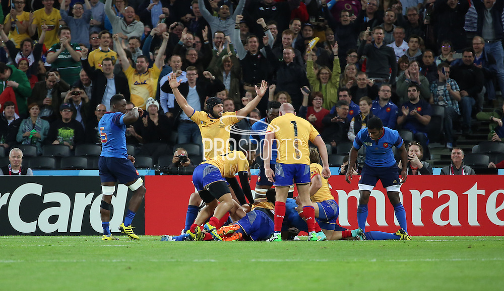 Romanians celebrate after they thought they had scored a try during the Rugby World Cup Pool D match between France and Romania at the Queen Elizabeth II Olympic Park, London, United Kingdom on 23 September 2015. Photo by Matthew Redman.