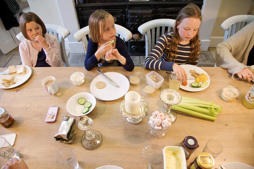 In the Bakers' kitchen, Pickwell Manor, Georgeham, North Devon, UK. From left to right: Liza Baker (9), Millie-grace Elliott (8), Molly Elliott (10).<br /> CREDIT: Vanessa Berberian for The Wall Street Journal<br /> HOUSESHARE