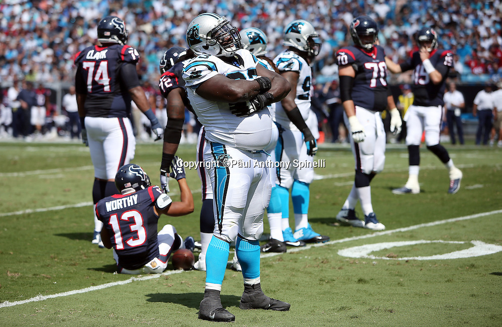 Carolina Panthers defensive tackle Kyle Love (93) celebrates a first quarter hit on Houston Texans wide receiver Chandler Worthy, negated by penalty, during the 2015 NFL week 2 regular season football game against the Houston Texans on Sunday, Sept. 20, 2015 in Charlotte, N.C. The Panthers won the game 24-17. (©Paul Anthony Spinelli)