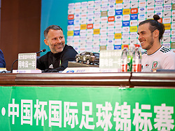 NANNING, CHINA - Thursday, March 22, 2018: Wales' new manager Ryan Giggs and record goal-scorer Gareth Bale attend the post-match press conference after the opening match of the 2018 Gree China Cup International Football Championship between China and Wales at the Guangxi Sports Centre. (Pic by David Rawcliffe/Propaganda)