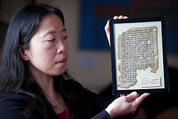 © Licensed to London News Pictures. 06/02/2013. London, UK. Lucy Cheng, a book and paper conservator from Cambridge University, holds up a copy of the 'Jerusalem Talmund' (thought to date from around 600 AD) part of the Lewis-Gibson Genizah Collection, at the British Academy in London today (06/02/2013). Oxford and Cambridge Universities today launched their first ever joint fundraising campaign to acquire the £1.2 million Lewis-Gibson Genizah Collection. The collection comprises more than 1,700 fragments of Hebrew and Arabic manuscripts, originating from the Cairo Genizah and dating from the 9th-19th century. Photo credit: Matt Cetti-Roberts/LNP
