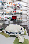 A model of the GE pavillion at the 1964-1965 World's Fair and an assortment of memorabilia in the Queens Museum.