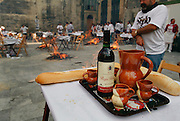 Thinly sliced lamb chops called chuletas are cooked over embers from burning grape vines at the annual wine harvest festival in Logroño, Rioja, Spain.