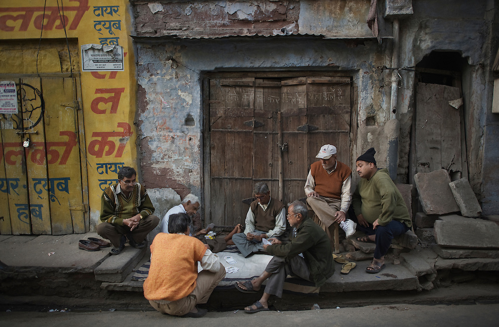 Men gamble at cards in the narrow street of the Old City of Jodhpur, India.<br />