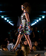 Omaha, NEB 9/19/09.A model wears a Dan Richters piece made out of recycled CDs...Chris Machian/The World-Herald