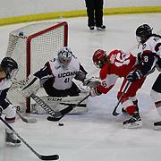 Sammy Davis, Boston University, challenges UConn goal tender goal Annie Belanger during the UConn Vs Boston University, Women's Ice Hockey game at Mark Edward Freitas Ice Forum, Storrs, Connecticut, USA. 5th December 2015. Photo Tim Clayton