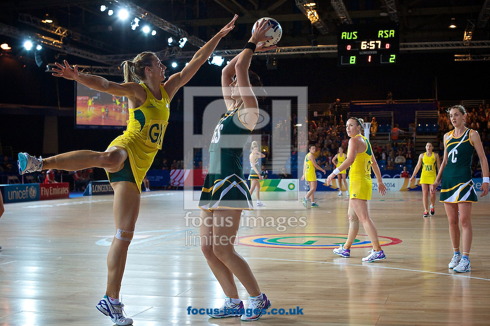 Australia (Yellow strip) and South Africa (Green strip) pictured during their Pool B Match during Netball Day Seven at SECC Precinct during Glasgow 2014 Commonwealth Games <br /> Picture by Ian Wadkins/Focus Images Ltd +44 7877 568959<br /> 30/07/2014