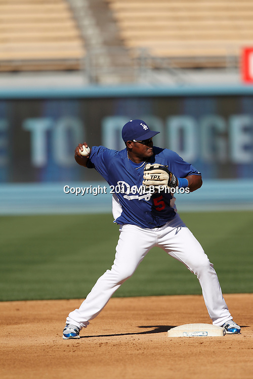 LOS ANGELES, CA - APRIL 15:  Second baseman Juan Uribe #5 of the Los Angeles Dodgers throws to first base during batting practice at the game between the St. Louis Cardinals and the Los Angeles Dodgers on Friday April 15, 2011 at Dodger Stadium in Los Angeles, California. (Photo by Paul Spinelli/MLB Photos via Getty Images) *** Local Caption *** Juan Uribe