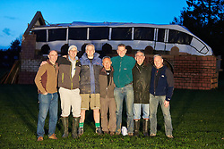© Licensed to London News Pictures.  02/11/2013. BUCKINGHAMSHIRE, UK. Members of the Speen Playing Fields Association stand in front of a 60 foot scale model of a HS2 train crossing a bridge they created. It will be used as a bonfire as part of the village annual firework display. <br /> <br /> Despite the village not being on the proposed route local residents are strongly opposed to the project as a waste of money. The model was created using recycled materials and was free to make. <br /> <br /> Photo credit: Cliff Hide/LNP