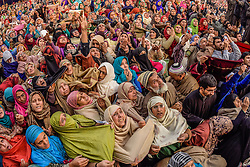 December 12, 2016 - Srinagar, Jammu and Kashmir, India - Kashmiri Muslim women devotees look towards a cleric (not seen in the picture) displaying the holy relic believed to be the whisker from the beard of the Prophet Mohammed,  at Hazratbal shrine during Eid-e-Milad , or the birth anniversary of Prophet Mohammad on December 12, 2016 in Srinagar, the summer capital of Indian administered Kashmir, India. Thousands of Kashmiri Muslims thronged to the shrine to pay obeisance on the  Eid-e-Milad , or the birth anniversary of Prophet Mohammed  to have the glimpse of the holy relic believed to be the whisker from the beard of the Prophet Mohammed. The relic is displayed to the devotees on important Islamic days such as the Eid- Milad when Muslims worldwide celebrate(Photo by Yawar Nazir/Nur Photo) (Credit Image: © Yawar Nazir/NurPhoto via ZUMA Press)