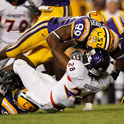 September 10, 2011; Baton Rouge, LA, USA;  LSU Tigers defensive end Sam Montgomery (99) tackles Northwestern State Demons running back D.J. Palmer (28) during the second half at Tiger Stadium. LSU defeat Northwestern State 49-3. Mandatory Credit: Derick E. Hingle