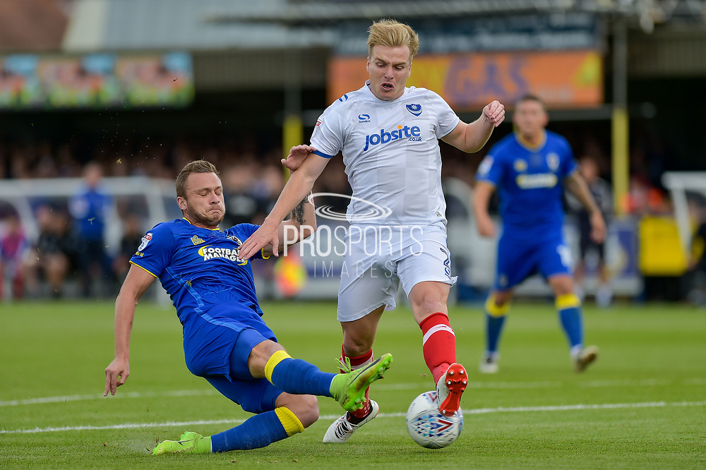 AFC Wimbledon Midfielder, Dean Parrett (18) has a shot block by Portsmouth Defender, Damien McCrory (2) during the EFL Sky Bet League 1 match between AFC Wimbledon and Portsmouth at the Cherry Red Records Stadium, Kingston, England on 9 September 2017. Photo by Adam Rivers.