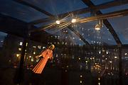 Three spotlights illuminate a angel floating over a nativity scene by the artist Tomoaki Suzuki, in Trafalgar Square, on 12th December 2017, in London England.