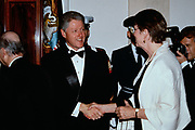 U.S. President Bill Clinton, center, shakes hands with Attorney General Janet Reno in the receiving line during the State Dinner at the White House February 5, 1998 in Washington, DC.
