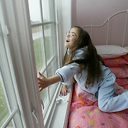 ANNABELLE -- ankeny, nov. 10 -- Annabelle Costanzo reacts to the natural light that comes in through the window of her bedroom at her home near Ankeny.  Annabelle, who had eye surgery on Friday in Detroit, can now detect light, something she hasn't been able to do since she was 3 years old.  photo by david peterson  mi