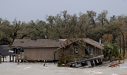 24 Sept, 2005. Cameron, Louisiana. Hurricane Rita aftermath. <br /> Route 27, Louisiana where the storm hit hardest on the Louisiana/Texas border. The back edge of Rita floods houses north of Cameron, Louisiana.<br /> Photo; ©Charlie Varley/varleypix.com