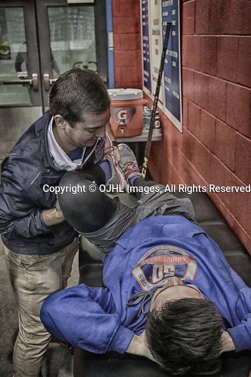OAKVILLE, ON  - MAR 3,  2017: Ontario Junior Hockey League, playoff game between the Oakville Blades and the North York Rangers. Oakville Blades training staff assist a player with pregame stretching.<br /> (Photo by Tim Bates / OJHL Images)