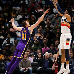 Mar 31, 2019; New Orleans, LA, USA; New Orleans Pelicans forward Christian Wood (35) shoots over Los Angeles Lakers forward Mike Muscala (31) during the first quarter at the Smoothie King Center. Mandatory Credit: Derick E. Hingle-USA TODAY Sports