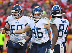 Jan 19, 2020; Kansas City, Missouri, USA;  Tennessee Titans tight end Anthony Firkser (86) celebrates with wide receiver Corey Davis (84) after scoring during the AFC Championship Game against the Kansas City Chiefs at Arrowhead Stadium. Mandatory Credit: Denny Medley-USA TODAY Sports
