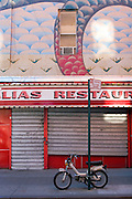 The painted, shuttered storefront of a restaurant on the Lower East Side of Manhattan.