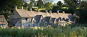 Arlington Row almshouses traditional row of old cottages in Bibury in the Cotswolds, Gloucestershire, England, UK