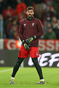 Liverpool goalkeeper Alisson Becker (13) warming up before the Champions League match between Bayern Munich and Liverpool at the Allianz Arena, Munich, Germany, on 13 March 2019.