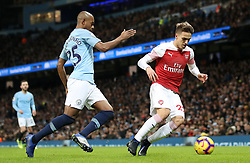 Manchester City's Fernandinho (left) and Arsenal's Denis Suarez during the Premier League match at the Etihad Stadium, Manchester.