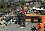 Neighbors cleaning up after a tornado tore through East Nashville