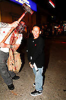 The scene in front of Blood Manor on Varick Street on October 14, 20.In this shot  Ervin Moran being scared on the street. They didn't make it through the entire Blood Manor experience had to be removed early.  Release on file.