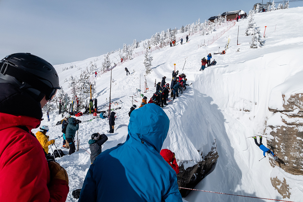 Parkin Costain with a massive backflip squirrel flight into the couloir.