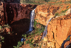 Water cascades over Fitzroy Bluff in the Kimberley wet season.
