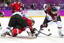 18.02.2014, Bolshoy Ice Dome, Adler, RUS, Sochi, 2014, Eishockey Herren, Playoff, im Bild Ronalds Kenins (LAT), Vitalijs Pavlovs (LAT) gegen Martin Pluess (SUI) // during Mens Icehockey Playoff Match between Switzerland and Latvia during the Olympic Winter Games Sochi 2014 at the Bolshoy Ice Dome in Adler, Russia on 2014/02/18. EXPA Pictures © 2014, PhotoCredit: EXPA/ Freshfocus/ Urs Lindt<br /> <br /> *****ATTENTION - for AUT, SLO, CRO, SRB, BIH, MAZ only*****