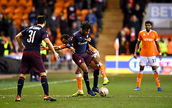 Arsenal's Alex Iwobi (centre, front) and Blackpool's Nathan Delfouneso battle for the ball during the Emirates FA Cup, third round match at Bloomfield Road, Blackpool.